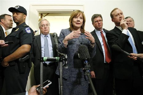 General Motors CEO Mary Barra (C) talks to reporters after testifying before the House Energy and Commerce Committee hearing on Capitol Hill