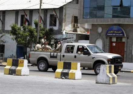 A military vehicle carrying soldiers rushes to the fourth military region after an attack in the southern city of Aden April 2, 2014. REUTER