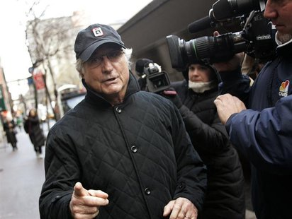 Bernard Madoff walks back to his apartment in New York December 17, 2008. REUTERS/Shannon Stapleton