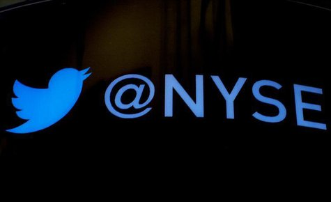 The Twitter logo is displayed ahead of the company's IPO on the floor of the New York Stock Exchange, November 6, 2013. REUTERS/Brendan McDe