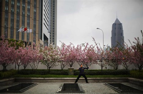 A man practices Tai Chi in a park at Pudong financial district in Shanghai April 2, 2014. REUTERS/Carlos Barria