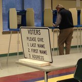 A voter casts a ballot during an election at the De Pere Community Center. (Photo from: FOX 11).