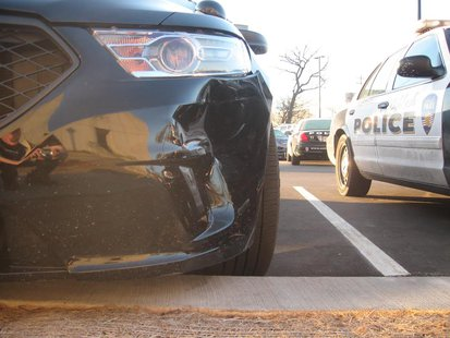 An Oshkosh police car that was damaged during an incident with a driver who was arrested for OWI, April 2, 2014. (Photo from: Oshkosh Police Department)
