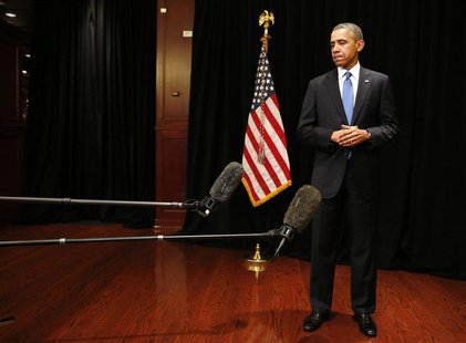 U.S. President Barack Obama stands alone as he makes a statement about the shooting at Fort Hood in Texas, while in Chicago, April 2, 2014.