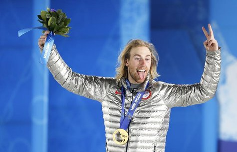 Gold medalist Sage Kotsenburg of the U.S. reacts during the medal ceremony for the men's snowboard slopestyle competition in the Olympic Pla
