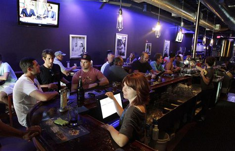Kristin Masson serves beers at Tequesta Brewing Co. in Tequesta, Florida April 2, 2014. REUTERS/Javier Galeano