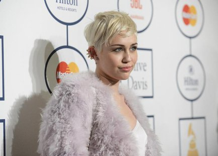 Singer Miley Cyrus attends the Clive Davis Pre-Grammy Gala and Salute to Industry Icons, honoring Universal Music Group Chairman and CEO Luc
