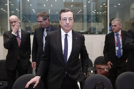 European Central Bank (ECB) President Mario Draghi takes his seat ahead of an European Union Finance Ministers informal meeting in Athens Ap