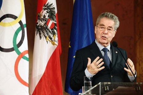 Austrian president Heinz Fischer addresses members of Austria's Olympic team during their swearing in ceremony inside the imperial Hofburg p