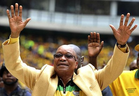 South Africa's President and leader of the ruling ANC party Jacob Zuma (C) greets his supporters as he arrives for the launch of his party's
