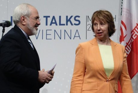 Iranian Foreign Minister Mohammad Javad Zarif (L) and European Union foreign policy chief Catherine Ashton leave a news conference in Vienna