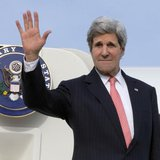 U.S. Secretary of State John Kerry waves goodbye as he leaves Brussels, to fly to Algeria, April 2, 2014. REUTERS/Jacquelyn Martin/Pool