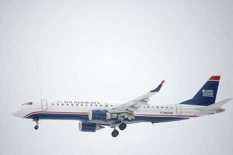 A US Airways Embraer ERJ-190 jet descends for landing at Philadelphia International Airport in Philadelphia, Pennsylvania on December 9, 201
