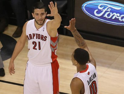 Apr 2, 2014; Toronto, Ontario, CAN; Toronto Raptors guard DeMar DeRozan (10) is congratulated by guard Greivis Vasquez (21) after scoring a