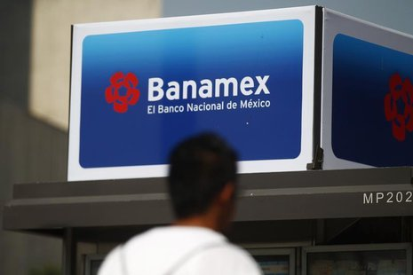 A man walks in front of a Banamex advertisement in Mexico City February 28, 2014. REUTERS/Edgard Garrido