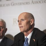 Governor Rick Scott (R-FL) answers a question during a news briefing at the 2013 Republican Governors Association conference in Scottsdale,