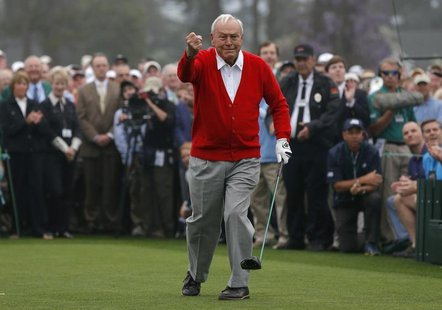 Arnold Palmer of the U.S. reacts after hitting his tee shot during the ceremonial start for the 2013 Masters golf tournament at the Augusta