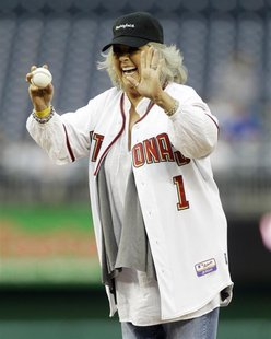 Food Network personality Paula Deen laughs before throwing out the first pitch prior to the Washington Nationals versus New York Mets MLB ba