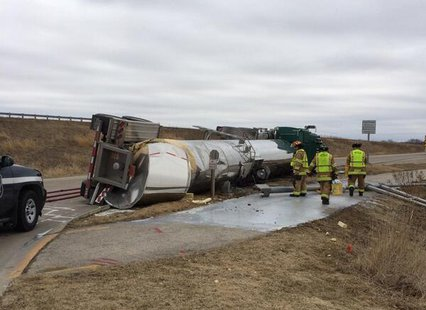 Firefighters work on an overturned milk truck in Fond du Lac, April 3, 2014. (Photo from: Fond du Lac Fire Department)