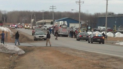 Emergency crews on the scene of a truck explosion in the village of Howard, Thursday, April 3, 2014. (Photo from: FOX 11).