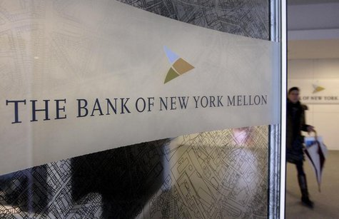 A woman walks past a logo at the office of the Bank of New York Mellon in Brussels, February 25, 2010. REUTERS/Sebastien Pirlet=