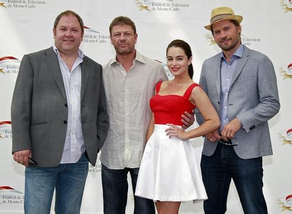 (L to R) Actors Mark Addy, Sean Bean, Emilia Clarke and Nikolaj Coster-Waldau who star in the television series 'Game Of Thrones' pose durin