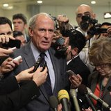 Senator Dan Coats (R-IN) talks to the media after former CIA Director David Petraeus testified at a Senate Intelligence Committee closed hea