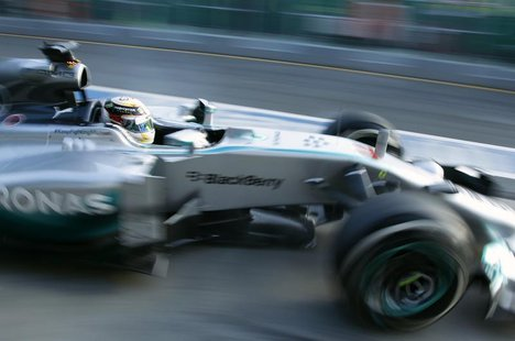Mercedes Formula One driver Lewis Hamilton of Britain drives out of the pits during the second practice session of the Australian F1 Grand P