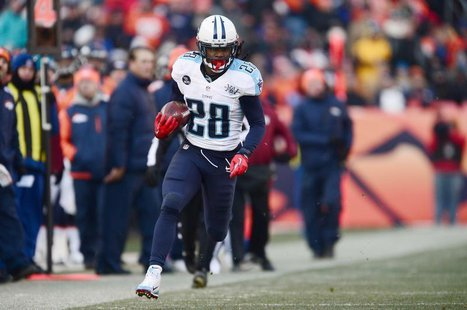 Dec 8, 2013; Denver, CO, USA; Tennessee Titans running back Chris Johnson (28) rushes on fourth down in the second quarter against the Denve