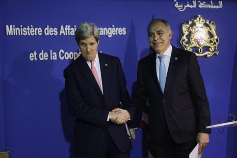 U.S. Secretary of State John Kerry (L) shakes hands with Moroccan Foreign Minister Salaheddine Mezouar at a news conference following a bila