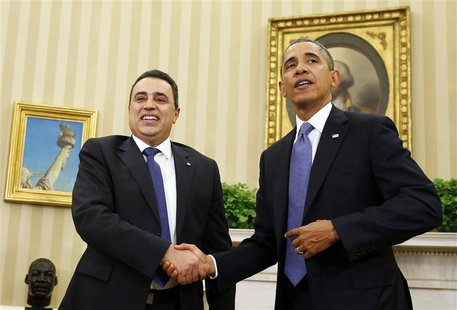 U.S. President Barack Obama and Tunisia's Prime Minister Mehdi Jomaa shake hands in the Oval Office of the White House in Washington, April