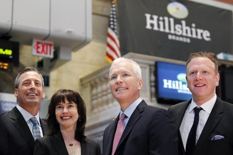 Hillshire Brands CEO Sean Connolly (2nd-R) poses with company executives on the floor of the New York Stock Exchange, July 3, 2012. REUTERS/