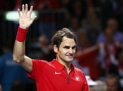 Roger Federer of Switzerland reacts during his Davis Cup quarter-final tennis match against Mikhail Kukushkin of Kazakhstan in Geneva April