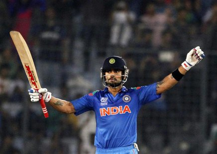 India's Virat Kohli celebrates after India won the semi final match against South Africa in the ICC Twenty20 World Cup at the Sher-E-Bangla