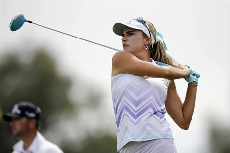 Apr 4, 2014; Rancho Mirage, CA, USA; Lexi Thompson tees off on the seventh hole in the second round of the Kraft Nabisco Championship golf t