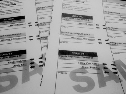 Two sample ballots with two different county board races is seen on April 2, 2014. (Photo from: FOX 11).