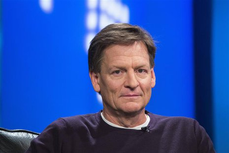 "Author Michael Lewis smiles during an interview at Reuters regarding his book about high-frequency trading (HFT) named ""Flash Boys: A Wall S"