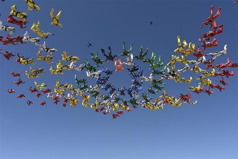 Skydivers form a missing man formation in Eloy, Arizona, April 3, 2014. . REUTERS/Henry Wiggers/Handout via Reuters
