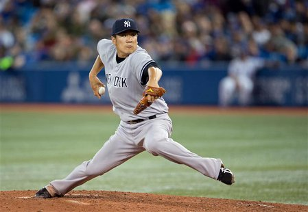 Apr 4, 2014; Toronto, Ontario, CAN; New York Yankees starting pitcher Masahiro Tanaka (19) throws a pitch during the fourth inning in a game