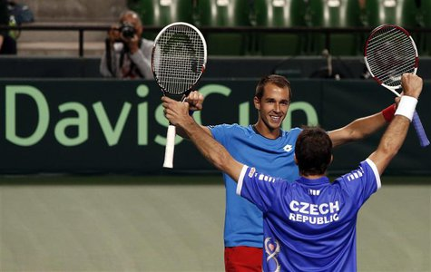 Lukas Rosol (facing camera) and Radek Stepanek of the Czech Republic celebrate after winning their Davis Cup men's doubles quarter-final ten