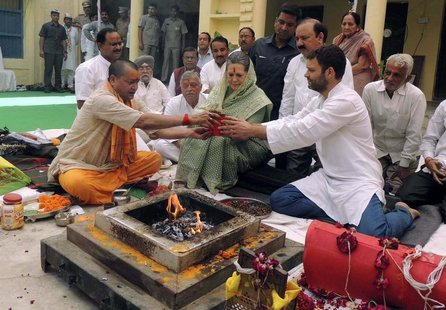 Chief of India's ruling Congress party Sonia Gandhi (C) and her son and Vice President of Congress Rahul Gandhi (front R) perform a religiou