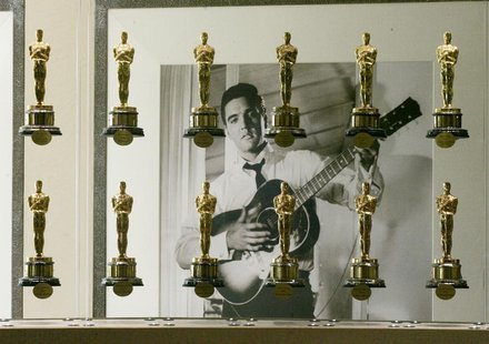 A photograph of the late singer and actor Elvis Presley is framed by a portion of the Academy Awards bestowed upon films from movie studio M