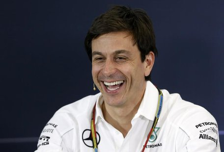 Mercedes Formula One Executive Director (Business) Toto Wolff smiles during a news conference after the second practice session of the Austr