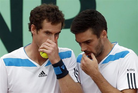 Britain's Andy Murray (L) chats with teammate Colin Fleming during their Davis Cup quarter-final doubles tennis match against Italy's Fabio