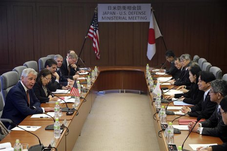 U.S. Secretary of Defense Chuck Hagel (L) speaks as Japan's Defense Minister Itsunori Onodera (3rd R) listens during their meeting at the de