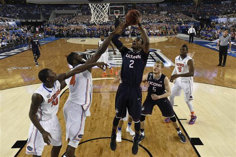 Apr 5, 2014; Arlington, TX, USA; Connecticut Huskies forward DeAndre Daniels (2) shoots the ball against Florida Gators center Patric Young
