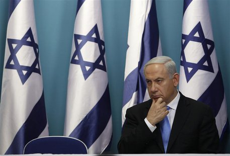 Israel's Prime Minister Benjamin Netanyahu sits after delivering a statement in Jerusalem November 21, 2012. REUTERS/Baz Ratner