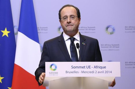 France's President Francois Hollande speaks at a joint news conference with Germany's Chancellor Angela Merkel (not pictured) during a Europ
