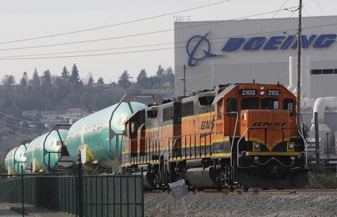 A BNSF train is pictured delivering Boeing 737 fuselages in Renton, Washington February 26, 2014. REUTERS/Jason Redmond