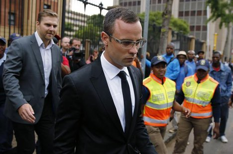 Oscar Pistorius leaves court after his trial for the murder of his girlfriend, Reeva Steenkamp, was postponed at the North Gauteng High Cour